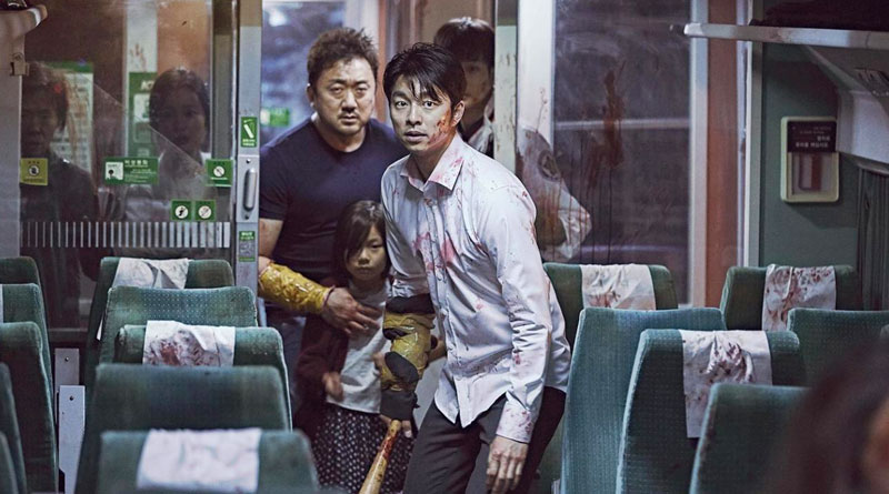 "Seok-woo (Gong Yoo) and Sang-hwa (Ma Dong-Seok) in ""Train to Busan""."