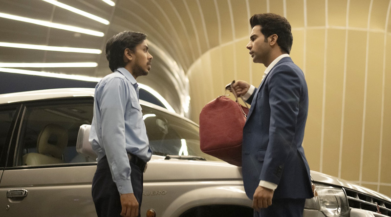 "Adarsh Gourav and Rajkummar Rao in Netflix's ""The White Tiger"" (2021)"